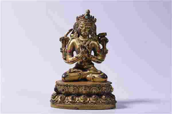 A GEMSTONE INLAID GILT BRONZE FIGURE OF TARA BUDDHA