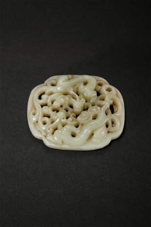A CREAMY JADE CARVING OF DOUBLE CHI-DRAGONS