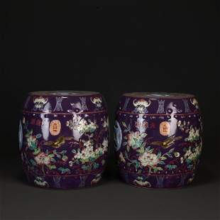 A PAIR OF PURPLE GROUND FAMILLE ROSE DRUM STOOLS