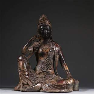 A GOLD-PAINTED BRONZE FIGURINE OF GUANYIN