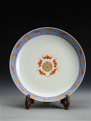 A BLUE AND WHITE IRON-RED 'BAT' PORCELAIN PLATE
