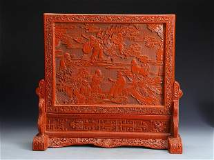 AN ARHATS ENGRAVED RED LACQUERED TABLE SCREEN