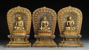 A SET OF GILT CUPRONICKEL TRIKALA BUDDHAS