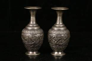 A PAIR OF 'PHOENIX' ENGRAVED SILVER VASES