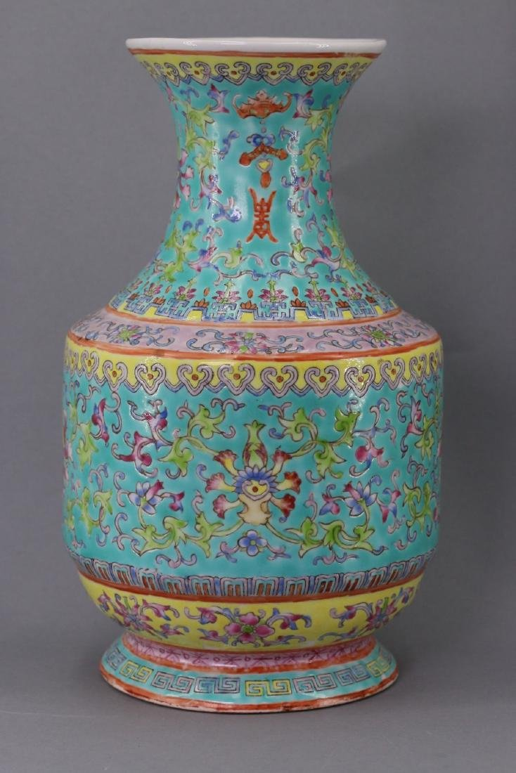 A Turquoise-Ground Famille-Rose Vase. Qing Dynasty