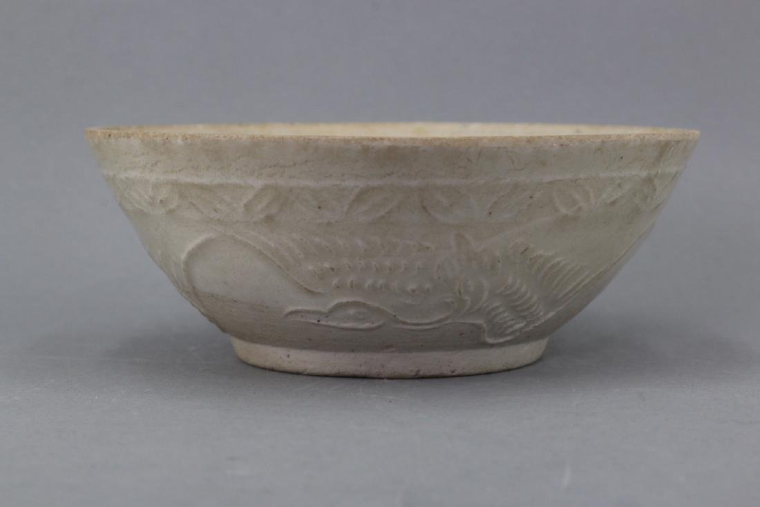 A Chinese Incised White Porcelain Bowl, Ming Dynasty.