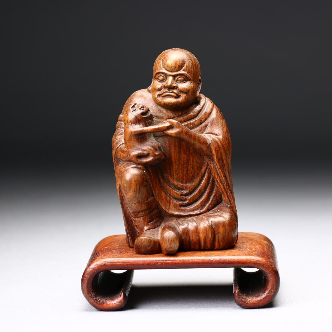 A Chinese Huangyang Wood Carved Figure