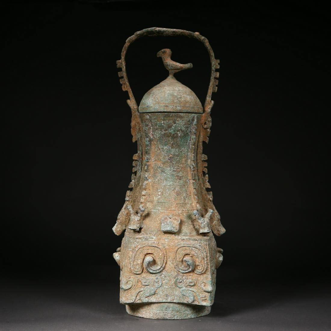 A Chinese Archaic Bronze ritual Wine Vessel w/ Lid