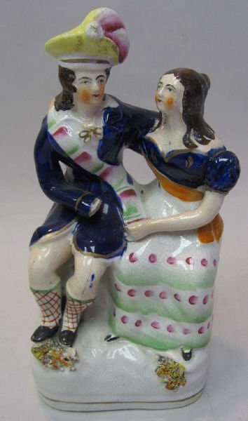23: A 19th C Staffordshire Figural Group