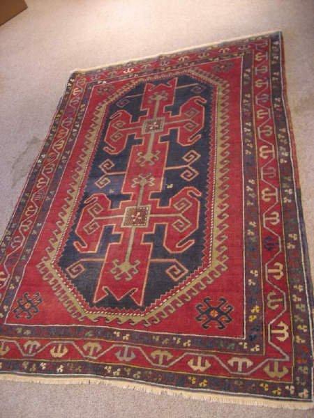 24: Semi-Antique Kazak Rug