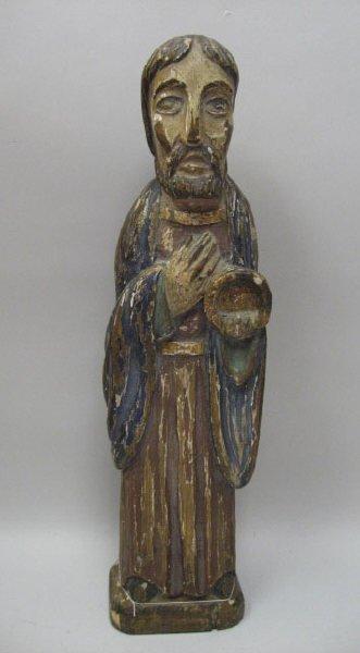 23: A Carved Wood Figure of a Saint,