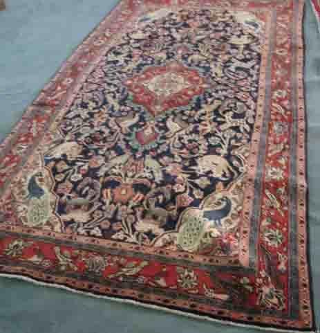 4: A Persian Sarouk Rug,