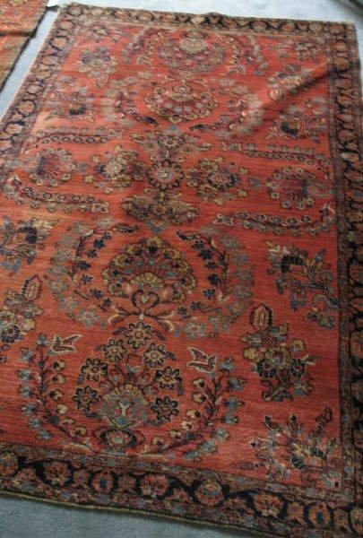 9: A Semi-antique Sarouk Rug.