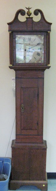 10: A Small and Early Oak Tall Case Clock,
