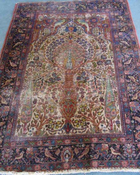 6: An Antique Kirman Prayer Rug,