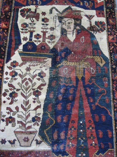 22: A North Persian Pictorial Rug,