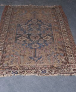 1008: An Antique Hamadan Rug,