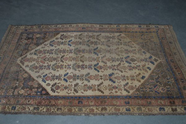 1015: A Semi-antique Mosul Rug,