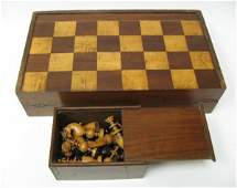 314: Chess / Backgammon Board Box w/ box of chess piece
