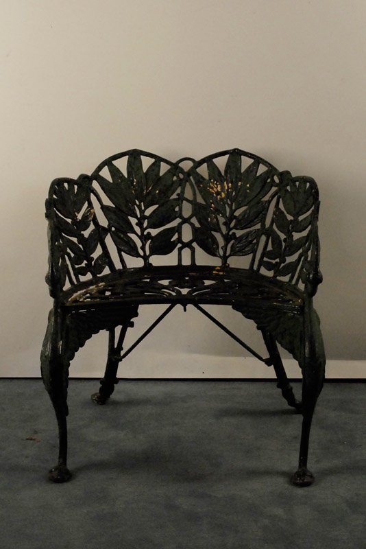 1009: A Painted Cast Iron Garden Bench,