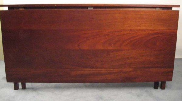9: A Large Mahogany Banquet Table in four parts,