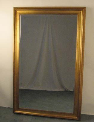 13: A Large Gilt Mirror,