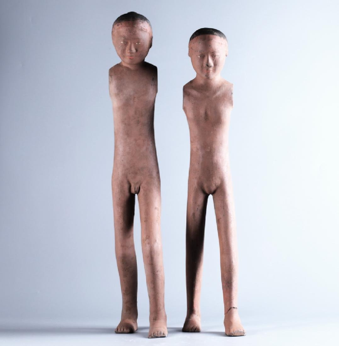 RED POTTERY CHARACTER FIGURE (PAIR)