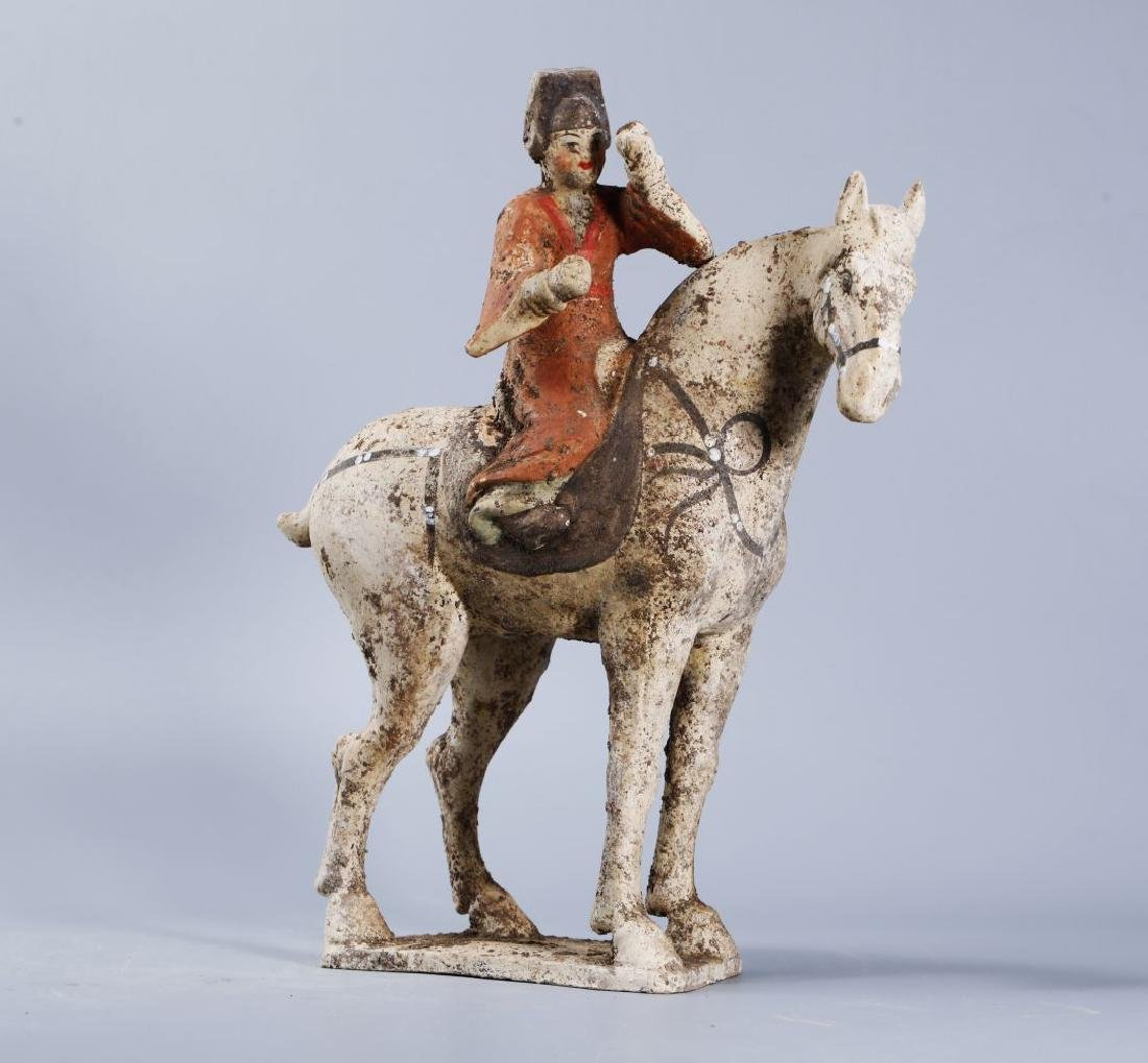WHITE POTTERY PATINTED POTTERY RIDING HORSE