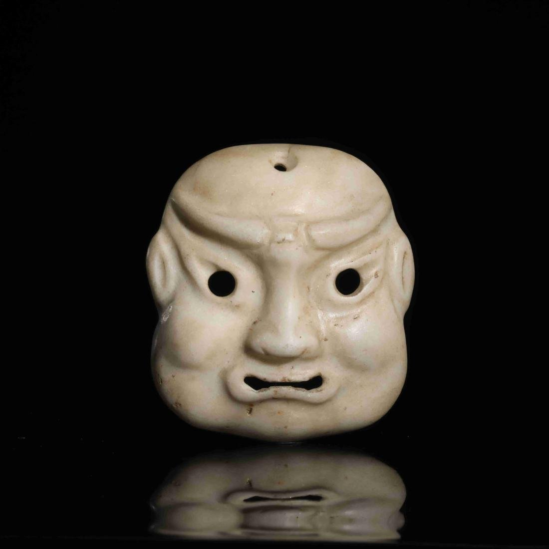 STONE CARVED MASK