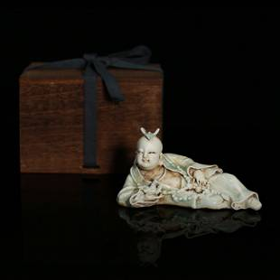 Hu Tian Kiln Laying Down Boy in Cyan White Color