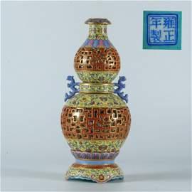 Qing Dynasty Yongzheng famille rose hollow revolving