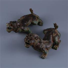 A pair of bronze beasts