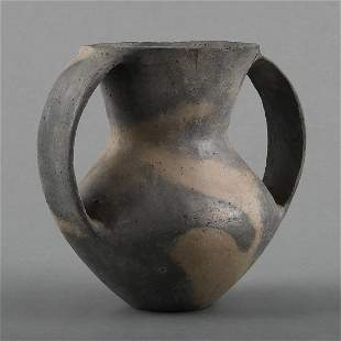 A BLACK POTTERY TWO-HANDLED AMPHORA