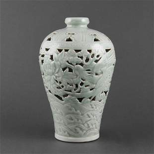 A CARVED AND RETICULATED CELADON MEIPING