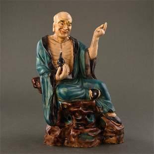 A SANCAI FIGURE OF LUO HAN, LIAO-STYLE