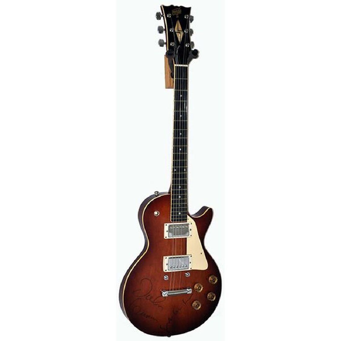 John Lennon + Yoko Ono Signed Guitar
