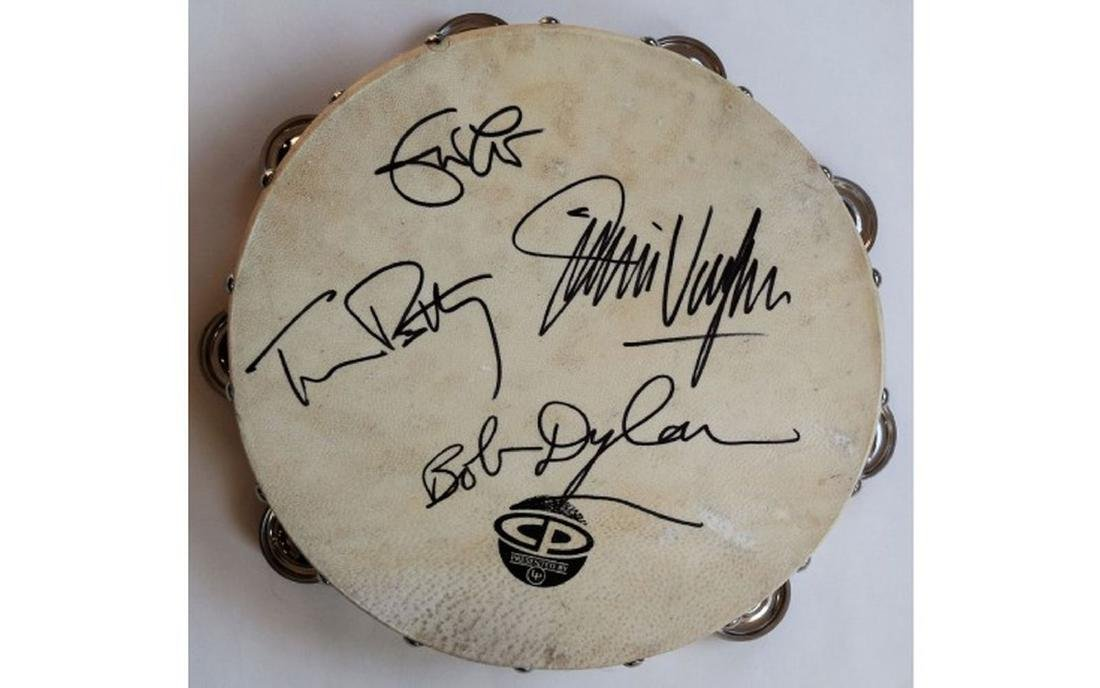 Signed by Clapton, Petty, Dylan, Vaughan Signed