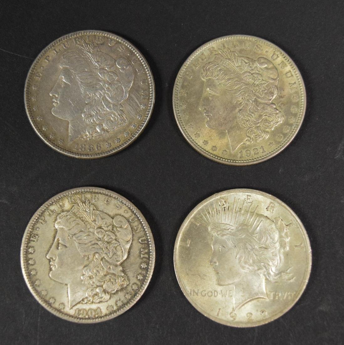 Four US Silver Dollars
