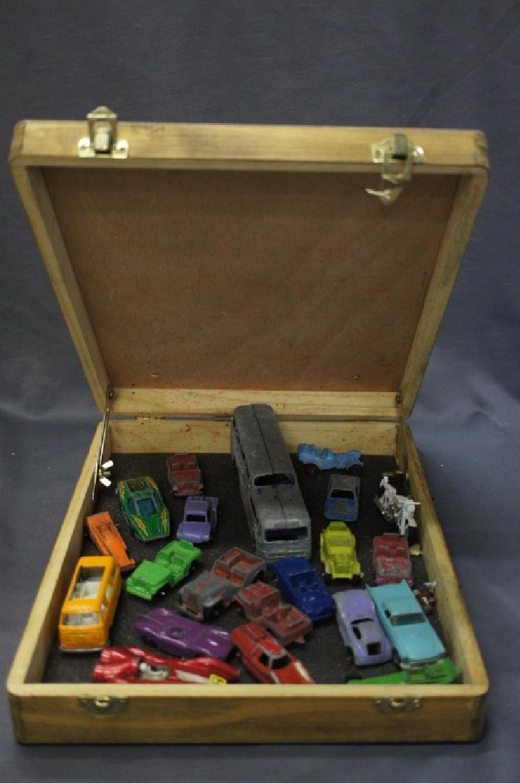 Wooden case filled with assorted vintage toy cars