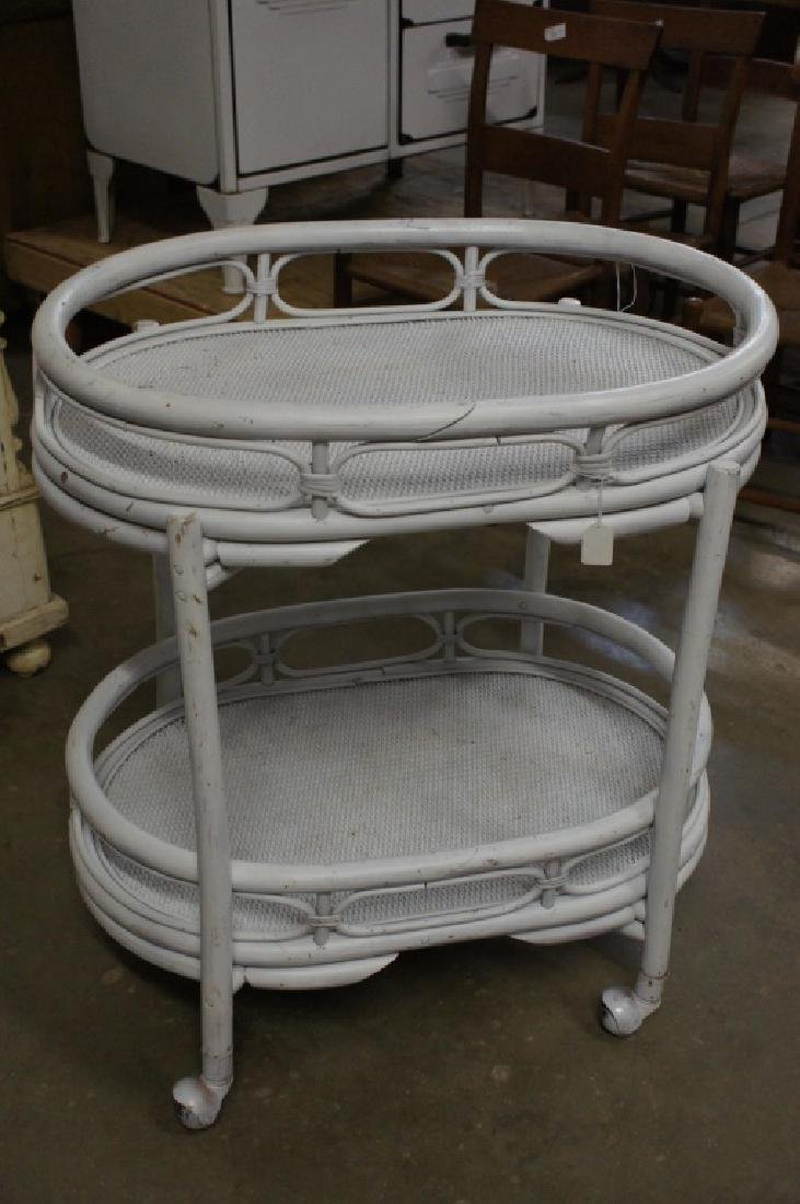 White wicker cart with wheels