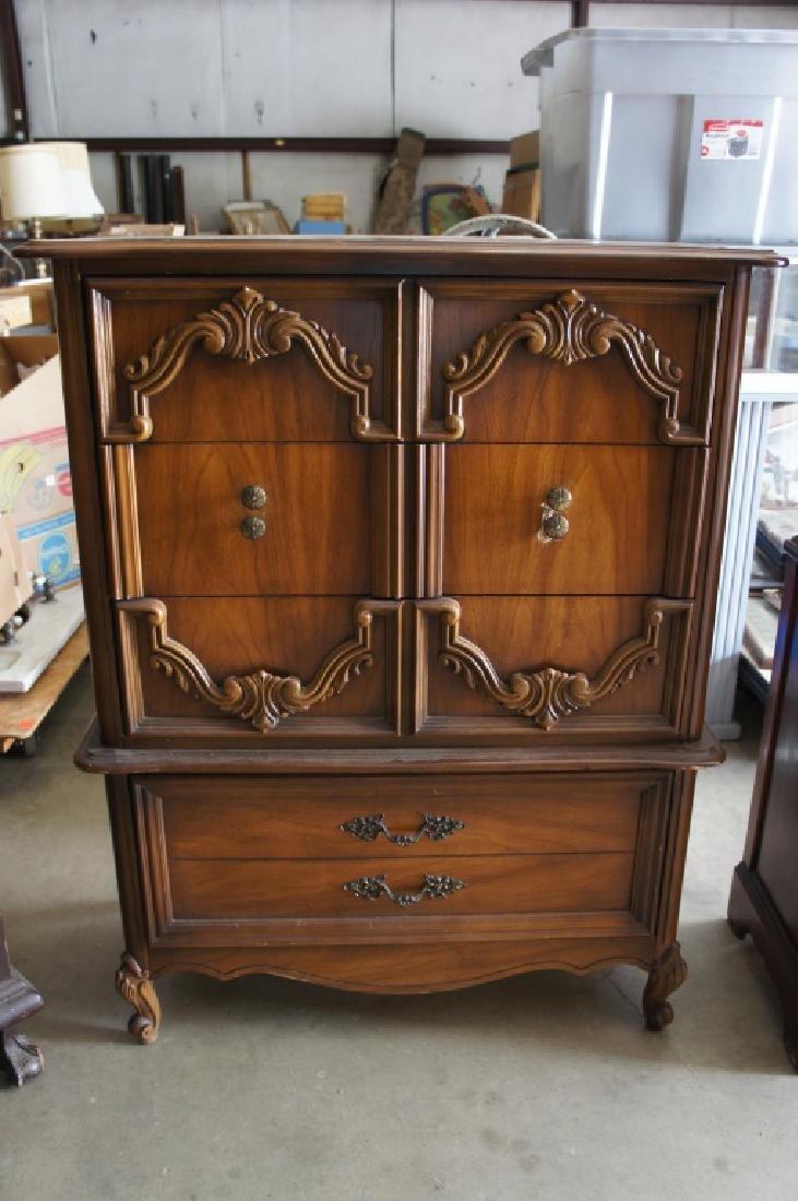 Ornately carved 4 drawer chest