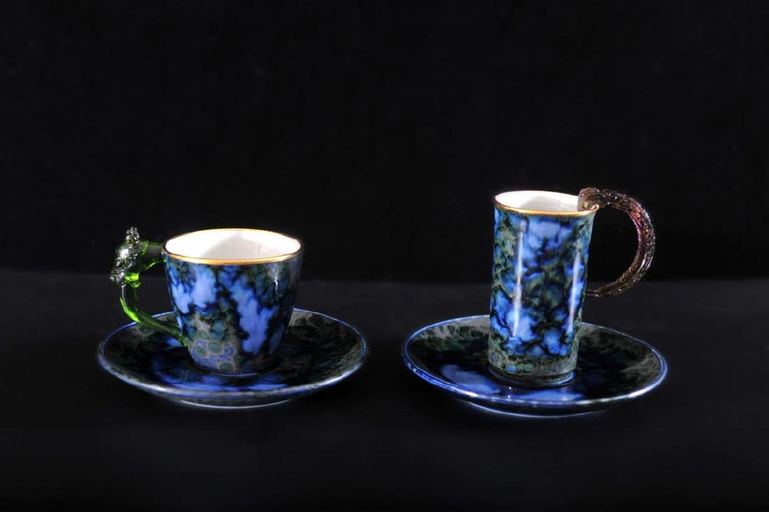 Two cups and saucers with glass handles