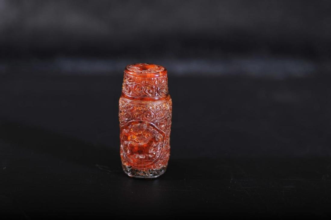 An amber carved and pierced container and cover