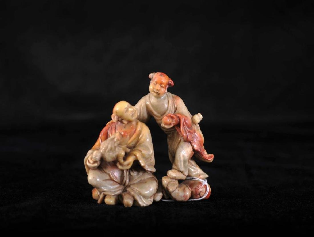 Soapstone carving of boys with toad