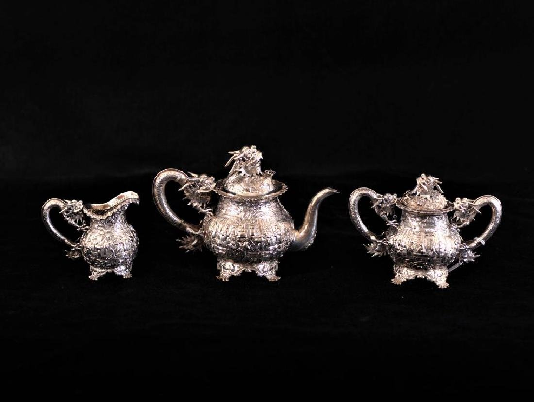 Chinese silver export 3 piece tea set decorated in