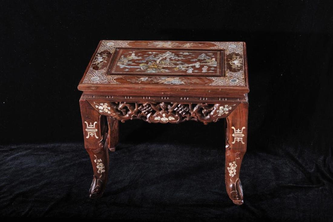 Carved hardwood stand inlaid
