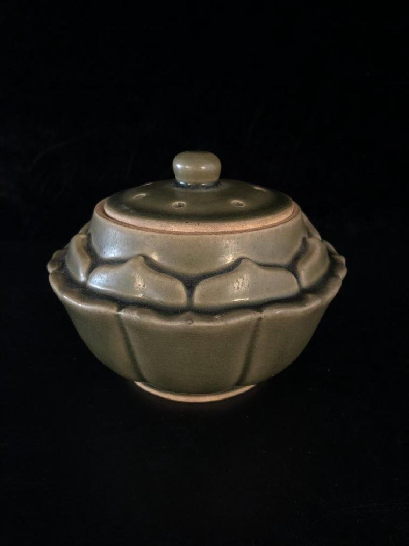 Green glazed lotus form bowl and cover