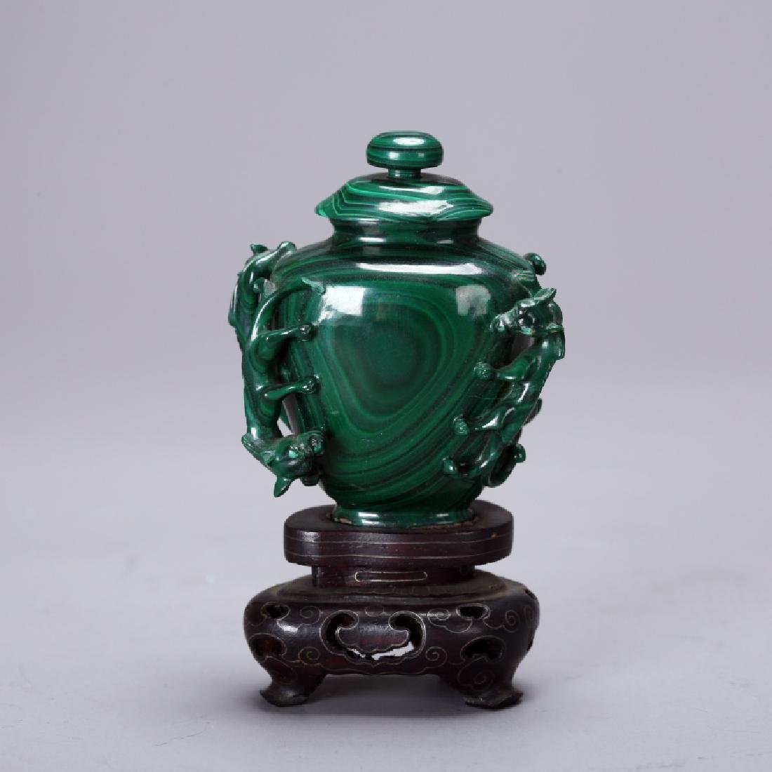 CHINESE CARVED MELACHITE SNUFF BOTTLE