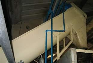 2: Screw auger feeding to steam peeler