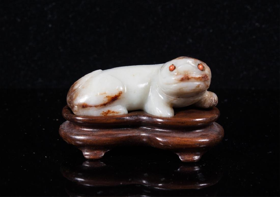 CHINESE YUAN DYNASTY WHITE JADE FOOLION WITH STAND